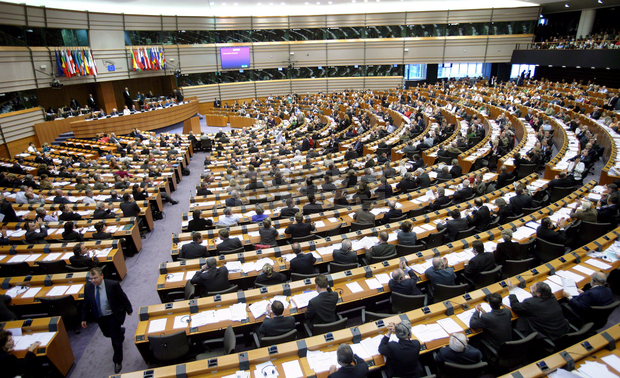"""epa01144203 Members of the European parliament attend a plenary session in Brussels, 11 October 2007. European Parliament vote on a report on how its seats should be allocated in the future, The total number of deputies in the legislative body should be limited to 750 compared to the current 785. The ceiling for a national delegation would be decreased from 99 to 96 seats and the minimum threshold would rise from five to six seats.  Seats would be shared on the basis of the """"degressive proportionality"""" principle, suggesting that """"the bigger the population of a member state, the higher must be the number of citizens each MEP represents"""" and vice versa.  EPA/OLIVIER HOSLET"""