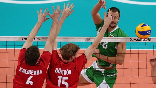 epa03351445 Nikolay Nikolov of Bulgaria in action against Germany in the Men's Volleyball Quarter Final at the London 2012 Olympic Games Volleyball competition, London, Britain, 08 August 2012.  EPA/GEOFF CADDICK