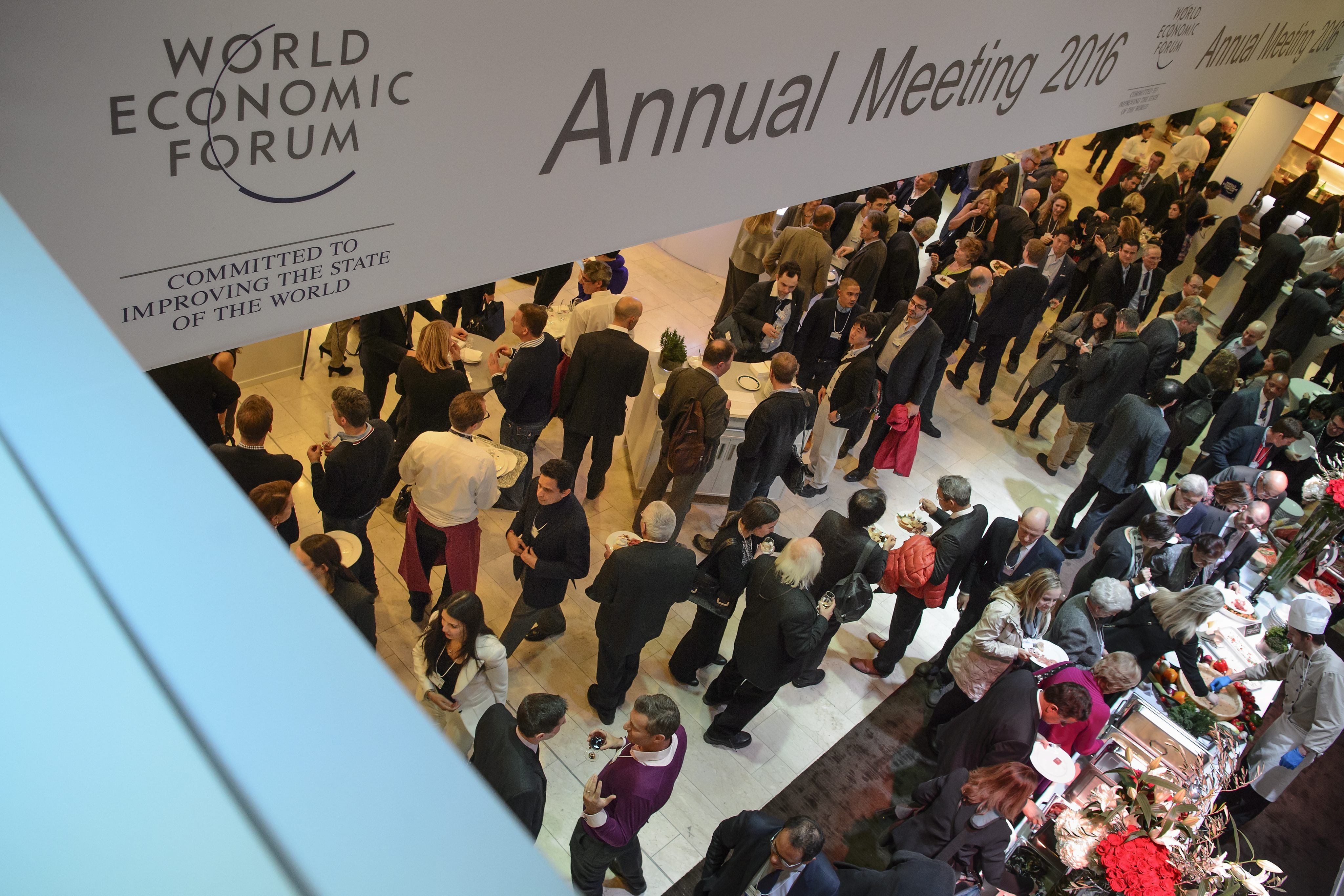 epa05111725 People gather for a dinner during the eve of the opening of the 46th Annual Meeting of the World Economic Forum, WEF, in Davos, Switzerland, 19 January 2016. The overarching theme of the meeting, which is expected to gather some 2,500 leading politicians, UN executives, heads of major corporations, NGO leaders and artists at the annual four-day gathering taking place from 20 to 23 January, is 'Mastering the Fourth Industrial Revolution'. EPA/JEAN-CHRISTOPHE BOTT