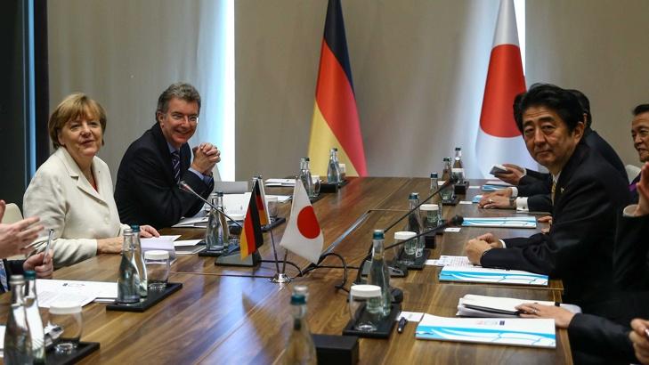 Меркел НАТО Япония